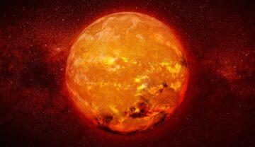 """Imagine cu o stea roșie pitică, în nuanțe de portocaliu și roșu închis. Planeta """"infernală"""" pe care plouă cu fier se află la sute de ani lumină de Pământ"""
